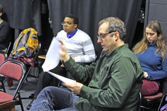 "Robert Neal looks over the Queen Anne monologue from ""Richard III"" during the Speech for the Stage course that he teaches at UIndy. (James Figy)"