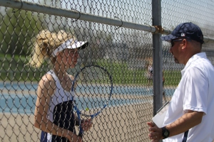 A Mooresville tennis player talks to the head coach during the Mooresville Invitational. (James Figy/The Reporter-Times)